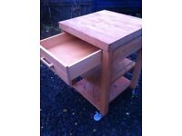 Solid oak butchers block kitchen island on lockable castors