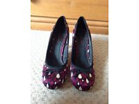 Size 5, quirky and unusual raindrop small heel shoes in purple and black. Worn once.