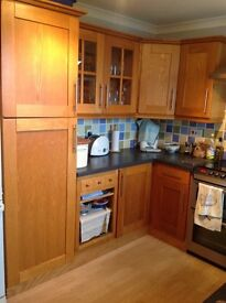 Oak fitted kitchen cabinets
