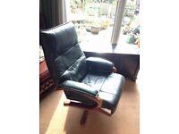 Leather armchair, dark green, swivels, very comfortable