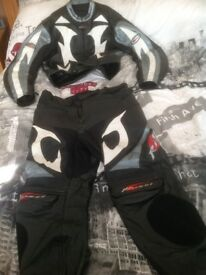 "Motorcycle leathers two piece, size 46, to fit 5'6"" tall."