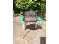 Charcoal barbecue with tools and accessories