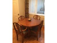 Ducal pine wood dining table and four chairs