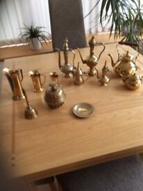 Collection of brass ornaments.