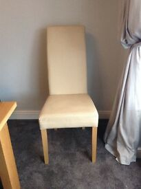 Two cream faux leather high back dining chairs,good condition,surplus to requirements