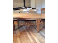 Stunning oak table and raffia style chairs.