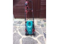 Bosch Rotak 34R Lawnmower, with 30 ft cable, 1 year old, excellent condition.
