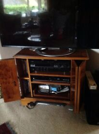 TV corner unit in yew, two shelves plus pull out draw. Doors on front.