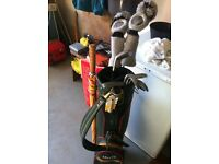 Set of men's golf clubs (right handed), plus bag and umbrella. Never used.