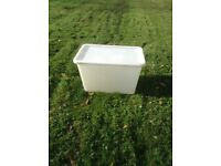 Collection of plastic storage boxes with lids