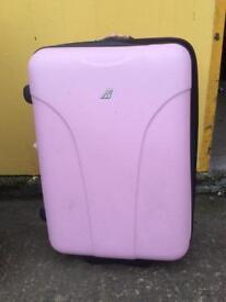 "Hard shell pink case. Height 26"" Depth 9"" Width 17"""