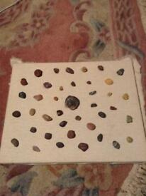Homemade natural canvas stone collage.