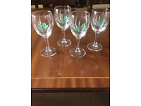 Very pretty french wine glasses with delicate painted design of holly & mistletoe on the side