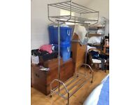 Hanging storage rack chrome plated on rollers