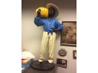 Antique statue of coloured boy with bananas/jardinaire
