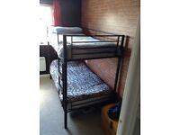 Black metal single bunk beds