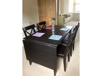 Black wooden drop-leaf dining table with 4 chairs