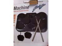 ELECTRONIC DRUM PADS, STICKS, MANUAL, 2 FOOT PEDALS AND TUTOR BOOK ALL IN VERY GOOD CONDITION