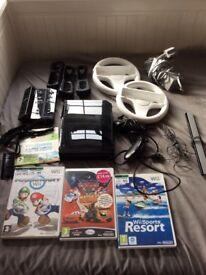 Nintendo wii black, balance board 3 controllers , 2 steering wheels