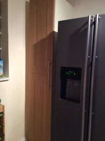 Complete kitchen units with worktop totalling 15 and a tall larder is excellent condition