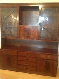 Mahogany wall unit with glass shelving and drinks cabinet