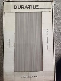 3 boxes of Large Grey strip tiles 10 per box brand new £30 OVNO