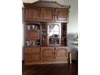 OAK DISPLAY WALL UNIT. Solid oak doors and trim with oak veneer carcass. Glazed display section