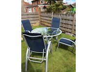 Glass patio table and aluminium adjustable chairs table is 4ft round..............................