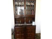 Dark wood dresser with glass leaded doors