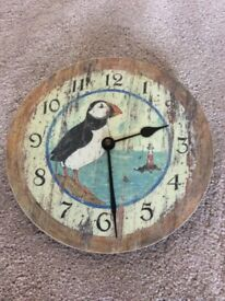 Clock - Battery operated. Puffin picture, comes with in instructions, foam cover & box.