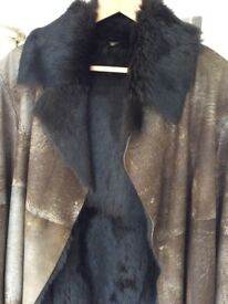 Luxury brown fur lined jacket, size 12.