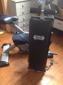 Exercise bike and sit up bench