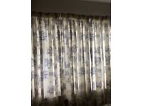 Cream and blue curtains 6 foot long and will fit window 8 to 9 foot wide