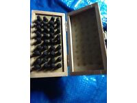 Small wooden box of punches with alphabet tips A-Z