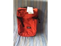 EASTPAK TRANSVERS CABIN CASE XS - CHERRY RED- NEW- 2 WHEEL- TENSION STRAPS