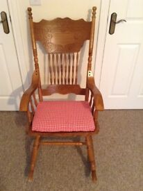 Rocking Chair, solid oak with beautiful wood carving, mint condition with removable seat pad