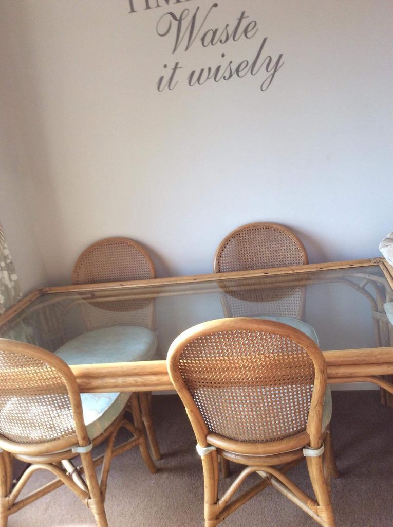 Cane Glass Topped Table And Chairs