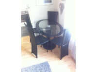 oval glass table plus 4 chairs