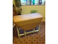 Lovely drop leaf table,sits 4,legs painted shabby chic pale grey.
