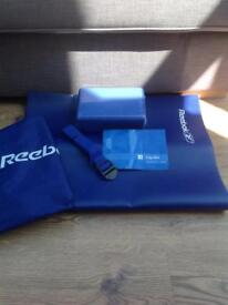 Brand new Reebok yoga mat, block and strap in carrying bag