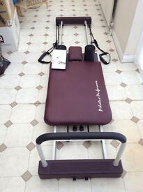 Pilates machine with dvd and excercise chart