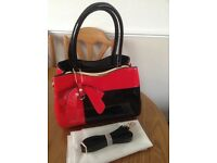 Red and black handbag.