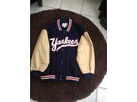 Yankees navy blue baseball jacket with beige leather sleeves
