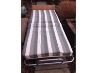 Folding single bed