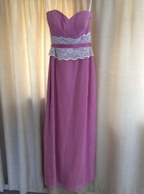 Woman's pink bridesmaid or prom dress in pink.