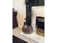 BLACK METALLIC ROUND DECORATIVE VASE with COMPLEMENTARY BLACK AND ARTIFICIAL LEAVES ORNAMENTS