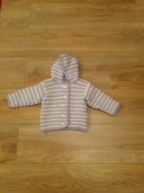 Baby's hand-knitted hooded cardigan.