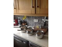 Set of three stainless steel pans