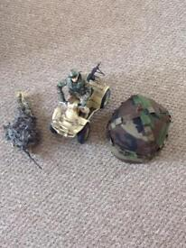 HM Armed Forces Quad with two figures and child's camouflage helmet