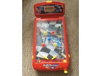 Pinball car racing machine